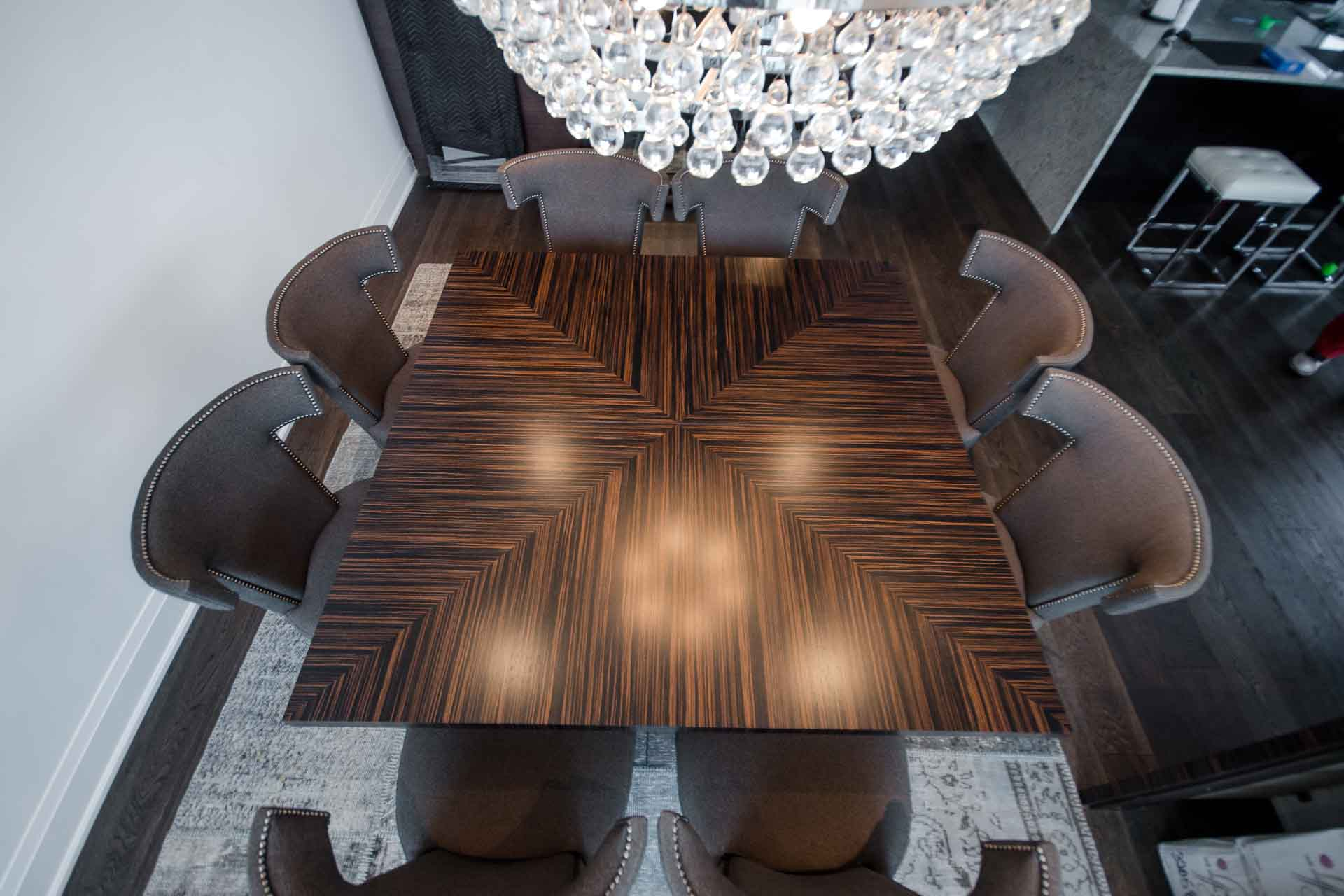 Dinning room table fabricated from zebrano veneer